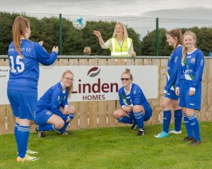 Can we have our ball back please? Linden Home's Abi Oates returns the ball to Evie Carroll and other members of the Blyth Town under 18s girls side (L/R) Evie Graham, Milly Kyle, Ellie O'Brien and Ellie Wilkinson.