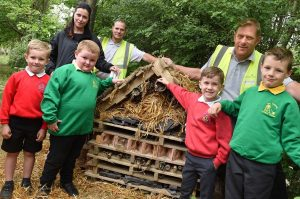 (L-R) Luke, Finley, Thomas and Marsden from Esh Winning Primary School and Our Lady Queen of Martyrs RC Primary School, 'checking out' The Bug Hotel with (back row L-R) Galliford Try Partnerships North's Hayley Bell, Lee Cole and Sean Nugent.