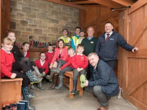 Trying out their wellies in the new store are (L to R seated): Faye Greenwell, seven; Laura Henderson, Work Placement Officer at Derwentside College; Amy Davison and Holly McCall, both 11; Zac Routledge, six; Angela McDermid; Josh Proctor and Zach Duffy, both six, with Ken Johnson (crouching).  (L to R standing): college students Callum Cook ,21; Bradley Colley and Chris Conlin, both 19; Peter Fox, Carpentry and Joinery Lecturer at the College and Geoff Scott.